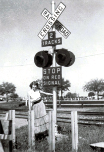 1955 crossbuck sign at train tracks