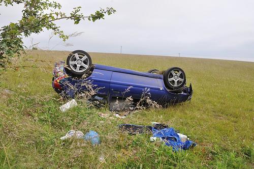 Overturned car with debris