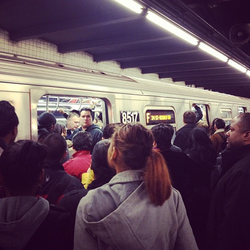 Crowded NYC subway stop
