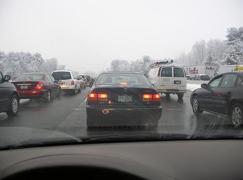 Car in a traffic jam on a snowy highway
