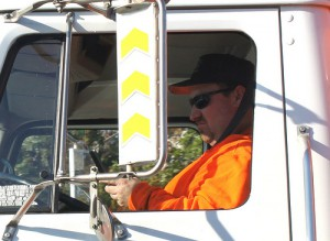 Truck driver texting behind the wheel
