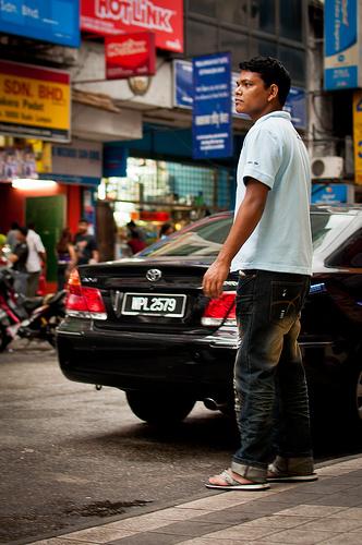 man crossing street in kuala lumpur